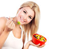 Pretty girl eating fruit salad Royalty Free Stock Photos