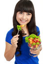 Pretty girl eating fruit salad, dieting Stock Photos