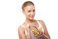 Pretty girl eating fruit salad isolated healthy fresh breakfast dieting and health care concept Royalty Free Stock Photo