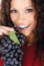 Pretty girl eating grape Stock Photo