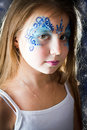 Pretty girl with face painting on black background of sign of the zodiac gemini Stock Photography