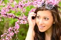 Pretty girl in flowers a young surrounded by spring Royalty Free Stock Photo