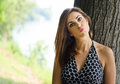 Pretty girl with funny expression outdoors in front of tree on her face Stock Image