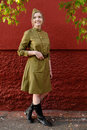 Pretty girl in garrison cap, high boots and Soviet war uniform a Royalty Free Stock Photo