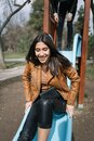 Pretty girl going down on a slide in park Royalty Free Stock Photo