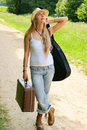 Pretty girl with guitar and baggage Stock Photo