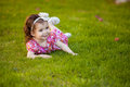 Pretty girl having fun at a park cute little hispanic laying on the grass and the Stock Photography