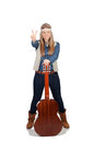 Pretty girl with hippie clothes and a guitar on white background Royalty Free Stock Images
