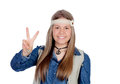 Pretty girl with hippie clothes making the peace symbol isolated on white background Stock Photos