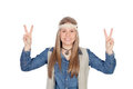 Pretty girl with hippie clothes making the peace symbol isolated on white background Royalty Free Stock Photo