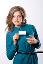 Pretty girl hold white blank paper beautiful woman show business card on background Stock Photos