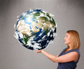 Pretty girl holding d planet earth young Stock Photography