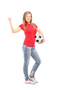 Pretty girl holding a football full length portrait of isolated on white background Royalty Free Stock Image