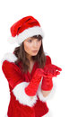 Pretty girl holding hands out in santa outfit on white background Stock Photo