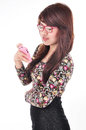 A pretty girl holding a mobile phone isolated on white background Stock Photos