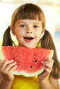 Pretty girl holding a piece of watermelon Stock Photography