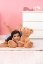 Pretty girl with huge soft toy bear Stock Photos