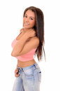 Pretty girl in jeans standing a lovely picture of a young woman and a pink top smiling isolated on white background Stock Photography