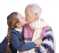 Pretty girl kissing her grandmother Royalty Free Stock Photos