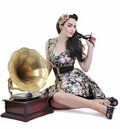 Pretty girl listening music on old gramophone Stock Photography