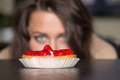 Pretty girl Looking to strawberry cake Royalty Free Stock Photo