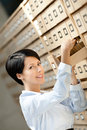 Pretty girl looks for something in card catalog Royalty Free Stock Photo