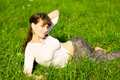 Pretty girl lying in grass Stock Photo