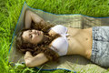 Pretty girl lying on green grass Royalty Free Stock Photo