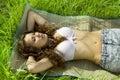 Pretty girl lying on green grass Royalty Free Stock Photo