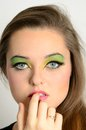 Pretty girl with makeup young female model colorful face closeup portrait photo of teenager Royalty Free Stock Images
