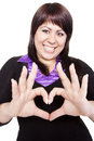 Pretty girl making a heart symbol with her hands Stock Image