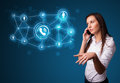 Pretty girl making phone call with social network icons young Royalty Free Stock Photo