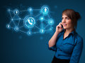 Pretty girl making phone call with social network icons young Royalty Free Stock Photos