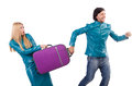 Pretty girl and man holding suitcases isolated on Royalty Free Stock Photo