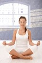 Pretty girl meditating in yoga studio eyes closed Royalty Free Stock Photo