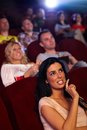 Pretty girl in multiplex movie theater Royalty Free Stock Photo