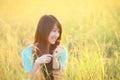 Pretty girl outdoor,beautiful teenage model girl on the field in sun light Royalty Free Stock Photo
