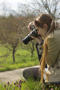 A pretty girl photographer in nature Royalty Free Stock Photos