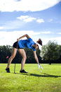 Pretty girl playing golf on grass in summer Stock Photos
