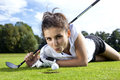Pretty girl playing golf on grass in summer Stock Image