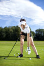 Pretty girl playing golf on grass in summer Royalty Free Stock Image