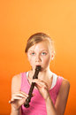 Pretty girl playing the recorder young Royalty Free Stock Photos
