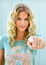 Pretty girl pointing her finger accusingly Royalty Free Stock Photos