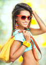 Pretty girl portrait of young with yellow handbag Royalty Free Stock Photos
