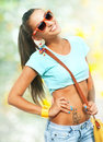 Pretty girl portrait of young with yellow handbag Stock Photos