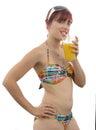 Pretty girl posing in bikini, drink orange juice, on white backg Royalty Free Stock Photo