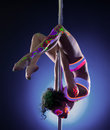Pretty girl posing hanging upside down on pylon young woman Stock Photography