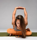 Pretty girl practicing yoga Royalty Free Stock Photo