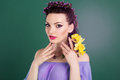 Pretty girl with purple flowers wreath in hair Royalty Free Stock Photo