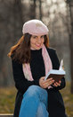 Pretty girl reading a book outdoors Royalty Free Stock Photography